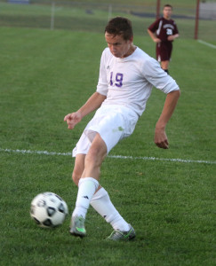 Christian Scholtz sends his game-winning goal into the back of the net Monday in Louisburg.