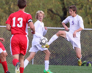 Defender Hunter Mitchell knocks the ball away from a  Fort Scott player Monday in Louisburg.