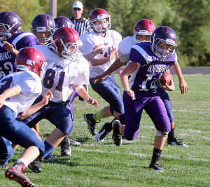 Louisburg seventh-grade quarterback Dawson Barnes finds some running room Tuesday at Wildcat Stadium.