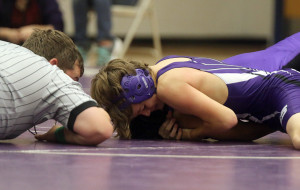 Eighth-grader Dalton Hilt works for a pin during a match earlier this season. Hilt finished the season with a 9-0 record.