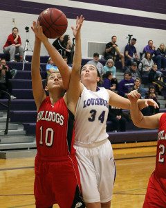 Junior Emalee Overbay goes up for a rebound against Anderson County on Friday.