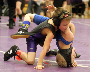 Bo Ballard tries to put an opponent on his back Saturday during a match at the Louisburg Wildcat Classic at Louisburg High School.