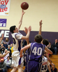 Connor Koesser puts up a shot in the lane during a game earlier this season at Louisburg Middle School.