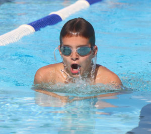 Braden Branine swims to the finish in the breaststroke against Woodson.
