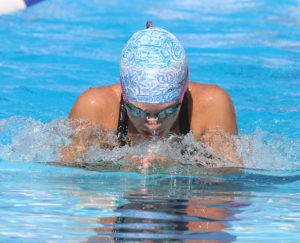 Elizabeth Kratochvil swims the breaststroke during Saturday's meet against Woodson.