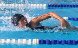 Claire Brown swims the 50-meter freestyle Saturday. Brown won four first-place ribbons.