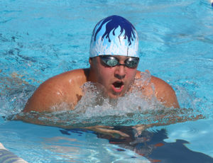 Christopher Tyson eyes the finish in the 50-meter breaststroke for the 15-and-over boys.