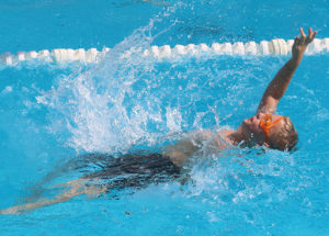 Wyatt Guetterman gets off to a good start in the backstroke Saturday.