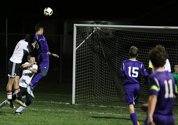 Noah Juarez heads the ball into the back of the net for Louisburg's third goal in the Wildcats' 3-1 win.