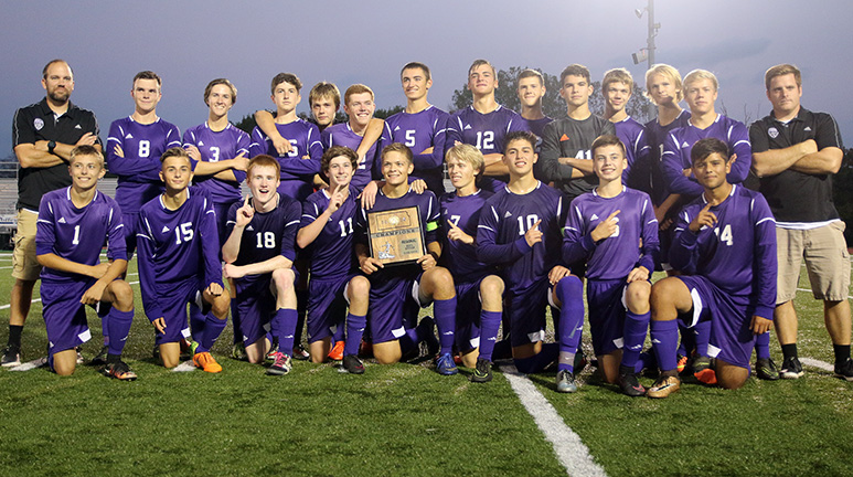 The LHS boys soccer team poses with its regional championship trophy following its shutout of Field Kindley. The Wildcats will play Trinity Academy on Tuesday in Louisburg in the state quarterfinals.