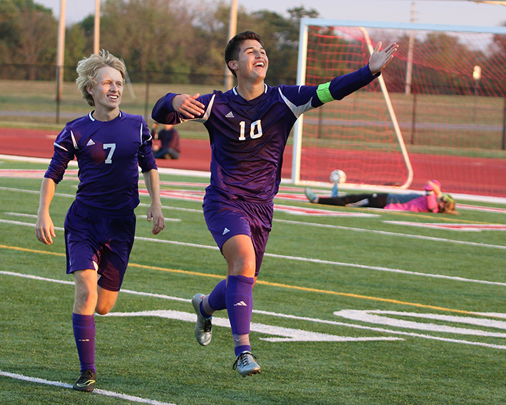 Senior Noah Juarez (right) looks up into the stands with teammate Ty Martin after one of his two second half goals Wednesday in Coffeyville.