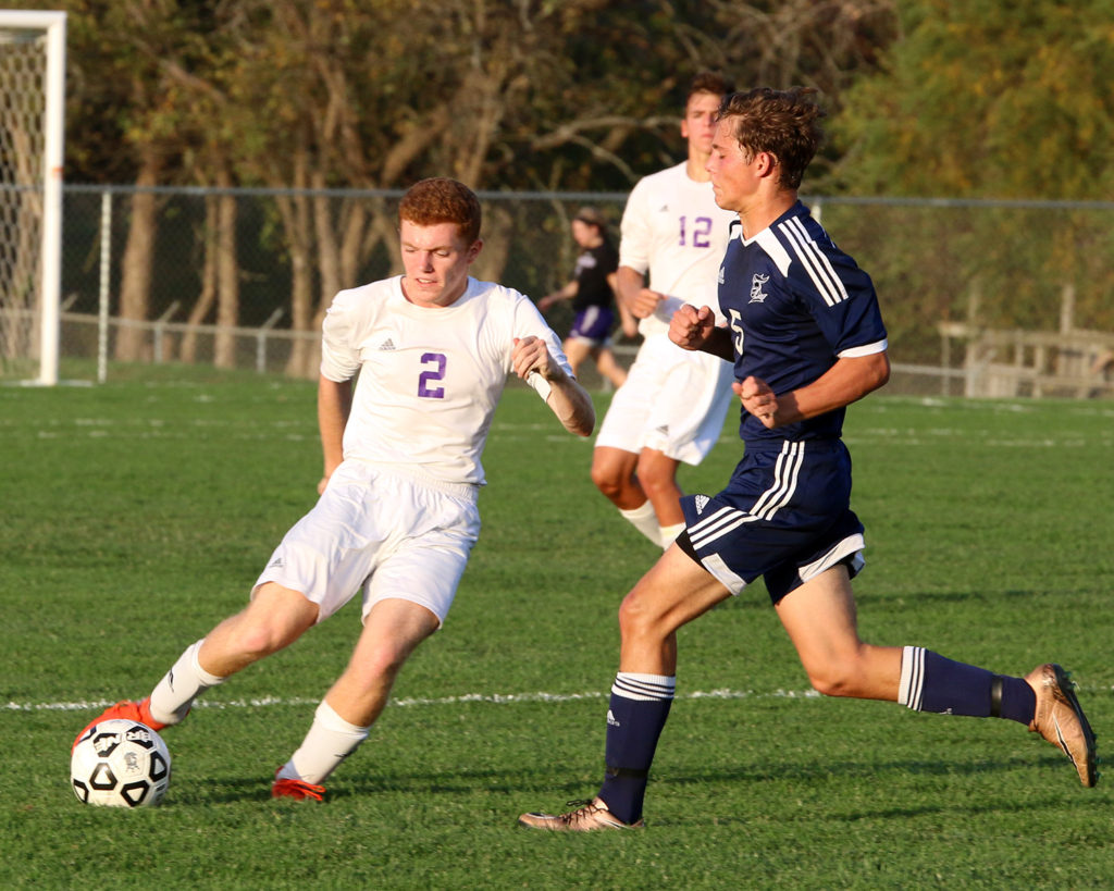 Senior Jacob Benne clears the ball away during Tuesday's state quarterfinal game.